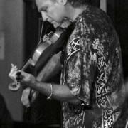 Thomas Goodlunas performing violin at Stella Blues on Maui