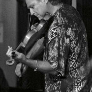 Thomas Goodlunas performing violin at Stella Blues on Maui
