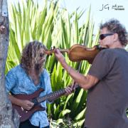 Jamming on fiddle along south slope of Haleakala, Kanaio, Maui